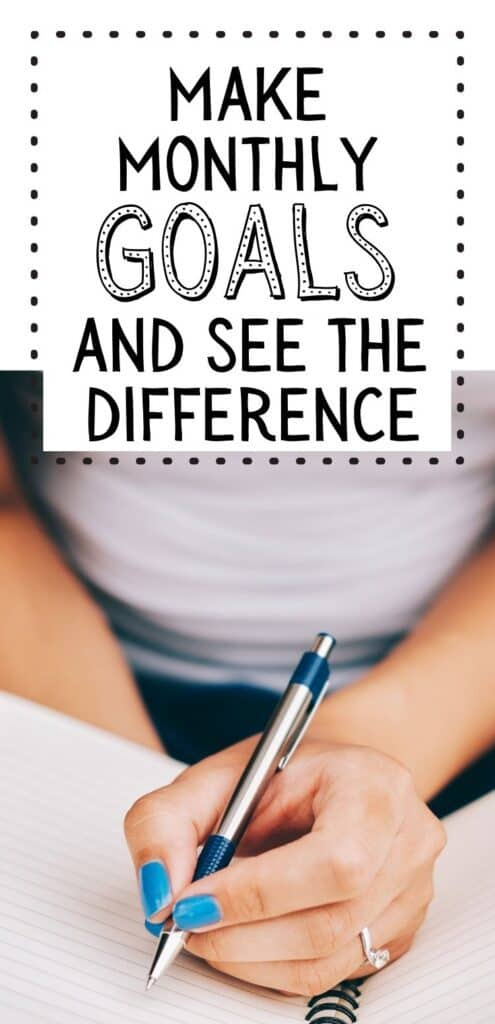 woman writing down monthly goals. Text overlay make monthly goals and see the difference