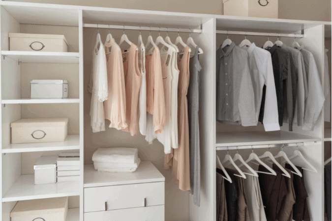Very organized closet with light pink shirts hanging perfectly and little white boxes on shelves