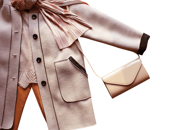An overlay with a light pink coat and a nude small purse