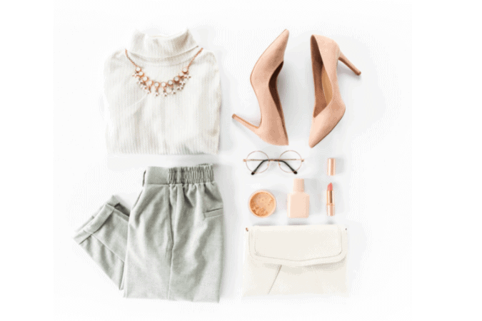 An overlay of an elegant outfit, with a folded white turtleneck, light pink heels, grey folded pants and some accessories